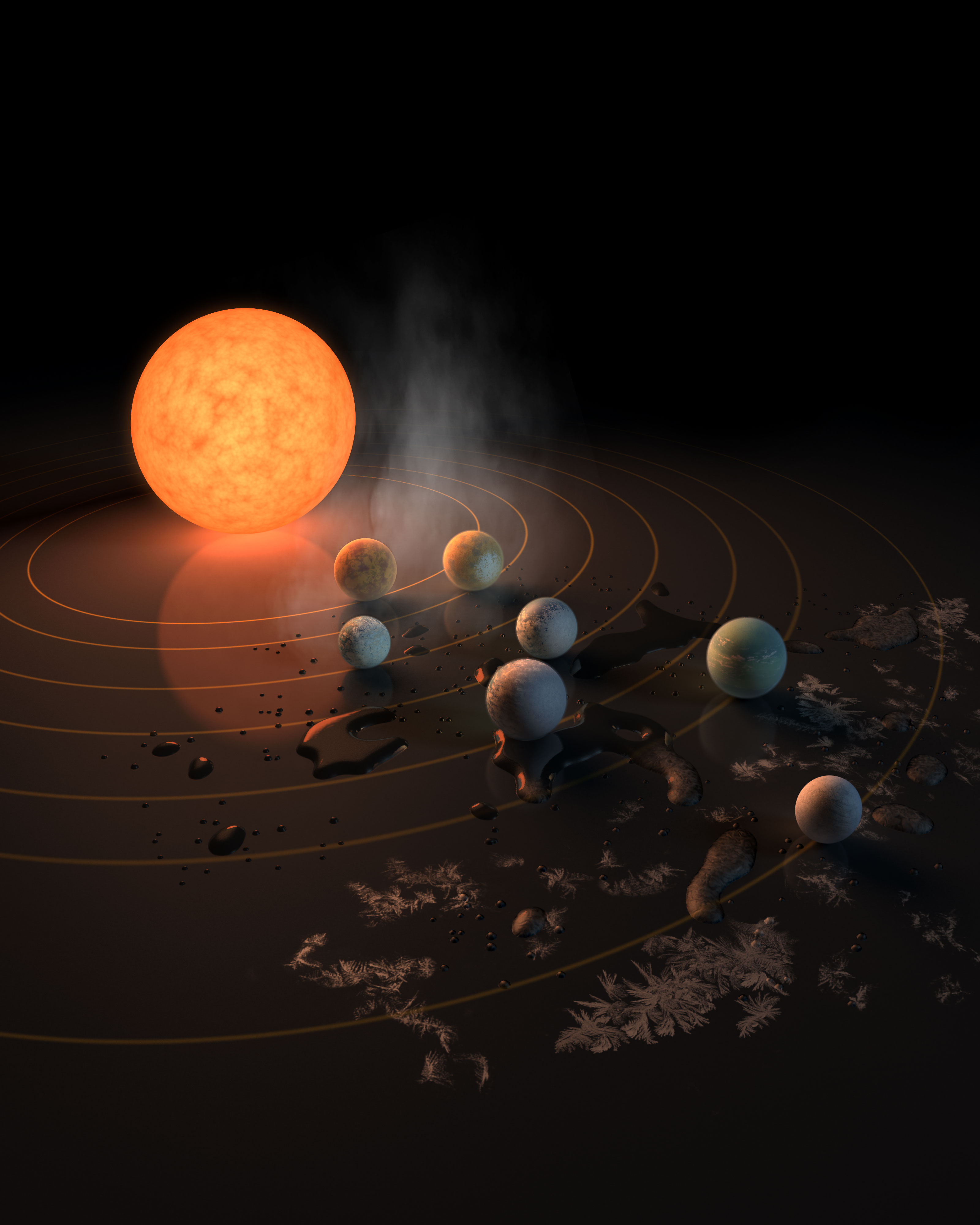 The TRAPPIST-1 star, an ultra-cool dwarf, has seven Earth-size planets orbiting it. This artist's concept appeared on the cover of the journal Nature on Feb. 23, 2017.