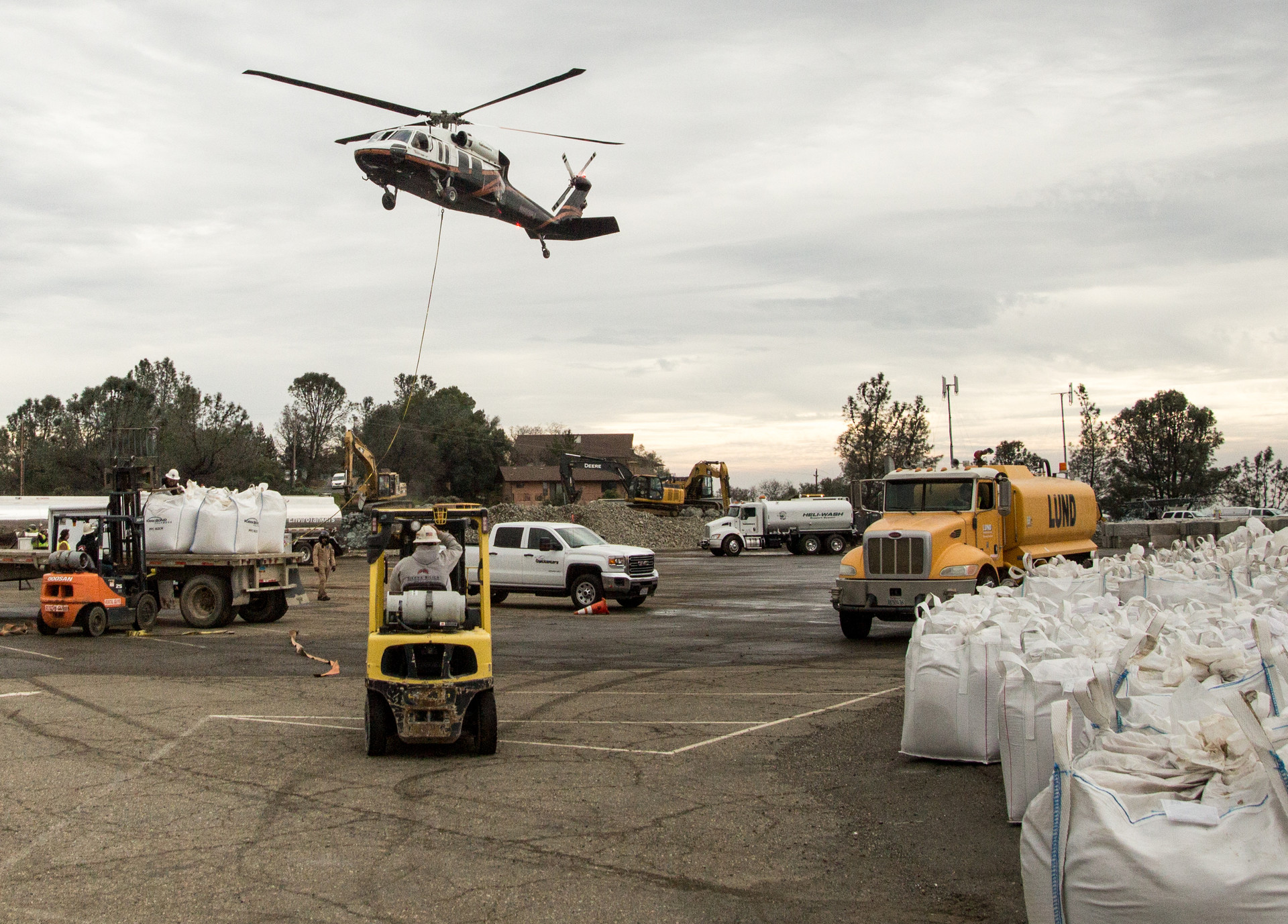 Blackhawk helicopters buzzed back and forth across the dam, carrying 4,000-pound sacks of rock and gravel.