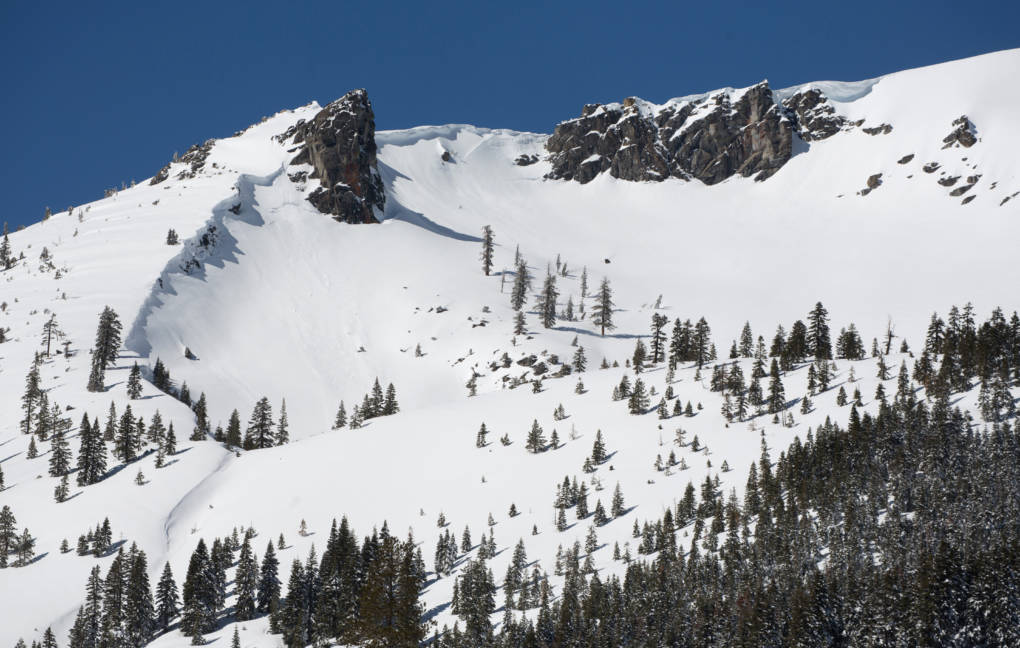 A snow-covered Sierra Nevada mountain peak to the northwest from the Phillips Station meadow, where the California Department of Water Resources conducted its third snow survey of the winter 2017 season. Photo taken March 1, 2017.