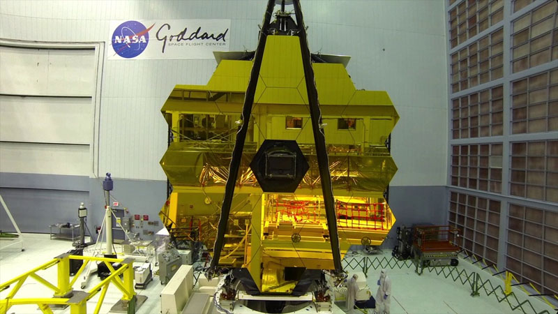 The James Webb Space Telescope with its 18-segment primary mirror fully assembled, in NASA/Goddard Space Flight Center's giant clean room in Greenbelt, Maryland.