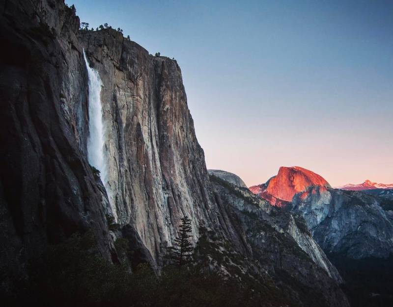 "From @theultimateaudball, via Instagram. ""For the second course, I bring you context. The milky Yosemite Falls on the left gives the hike its name, as you get a perfect view of the waterfall on the way up, and a breathtaking view out over the valley at the top. Next year, I hope to make a trip out in February to get a shot of the annual ""firefall"" ???? For now, I have ""strawberry-dome"" ????"""