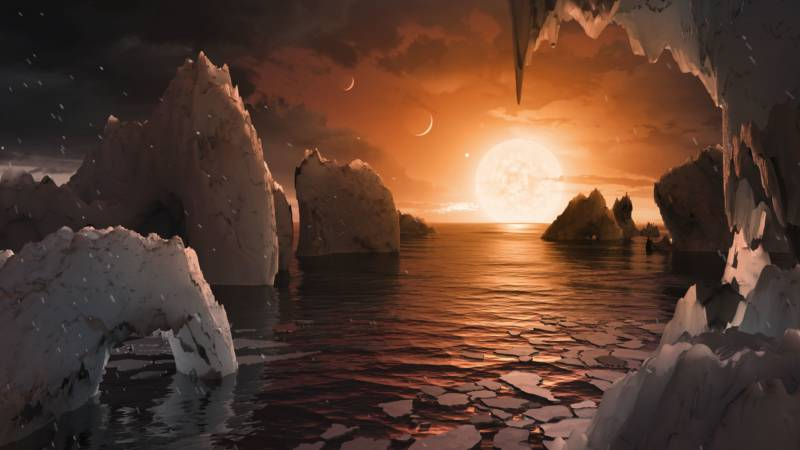 Artist concept of an exoplanet with possible surface water in the TRAPPIST-1 system, 40 light years from our solar system.