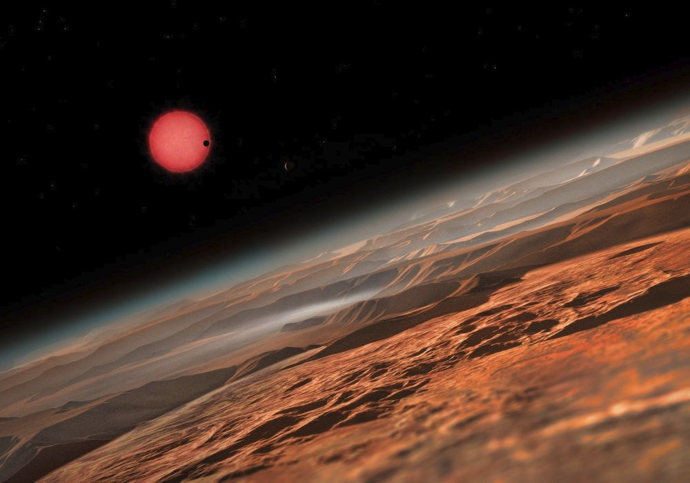 Artist concept of a planet in the TRAPPIST-1 system, three of which have the potential to support liquid water.