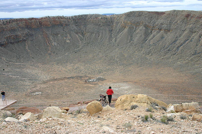 """Meteor Crater"" (also called Barringer Crater) near Winslow, Arizona. This three-quarter-mile-wide, 600-foot deep crater was formed by the impact of a 160-foot sized asteroid 50,000 years ago."