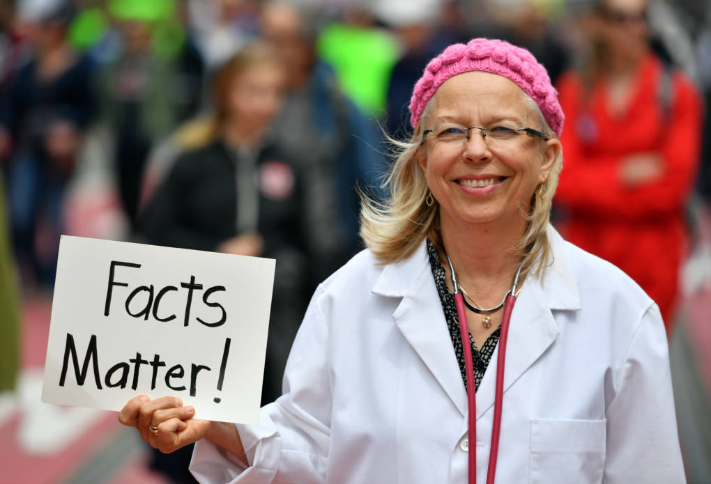 Liz Darner holds up a sign while participating in the March for Science in San Francisco.