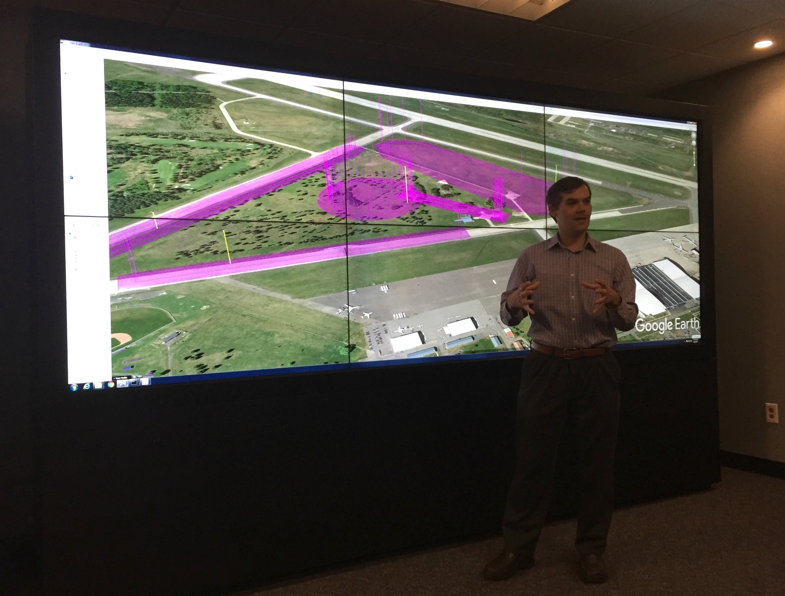 At NASA's Ames Research Center in Mountain View, Joey Rios, the drone traffic management project's technical lead, demonstrates how multiple drones flying close together can avoid colliding.