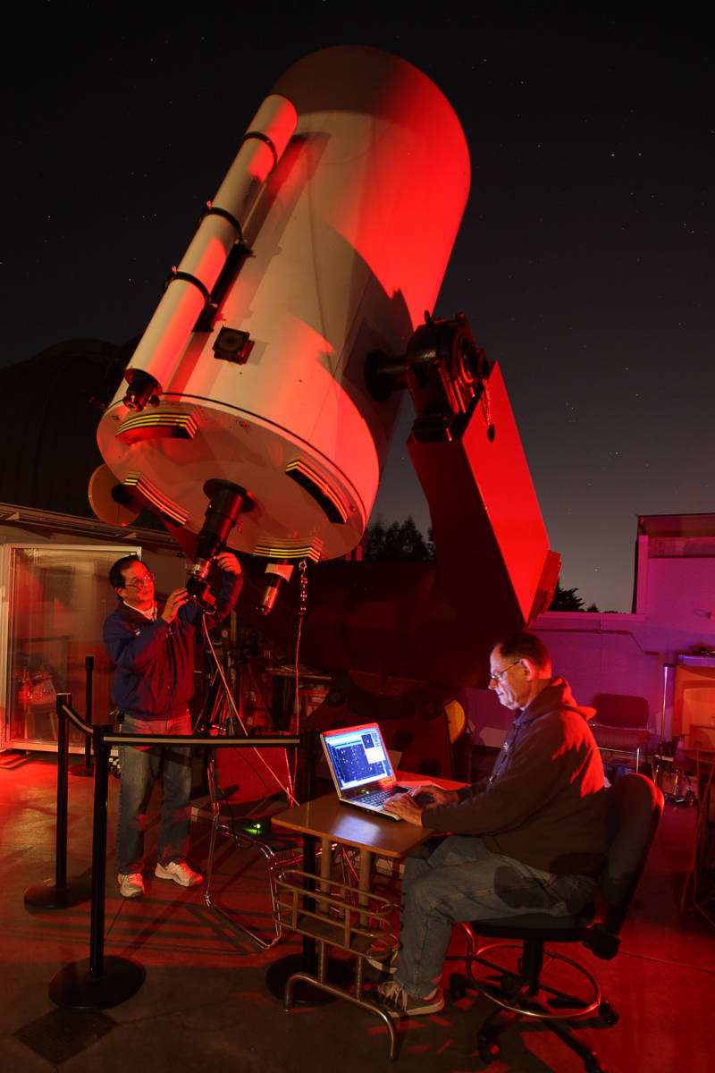 Chabot astronomers Gerald McKeegan and Conrad Jung, using the 36-inch telescope, Nellie, to track Near Earth Objects.