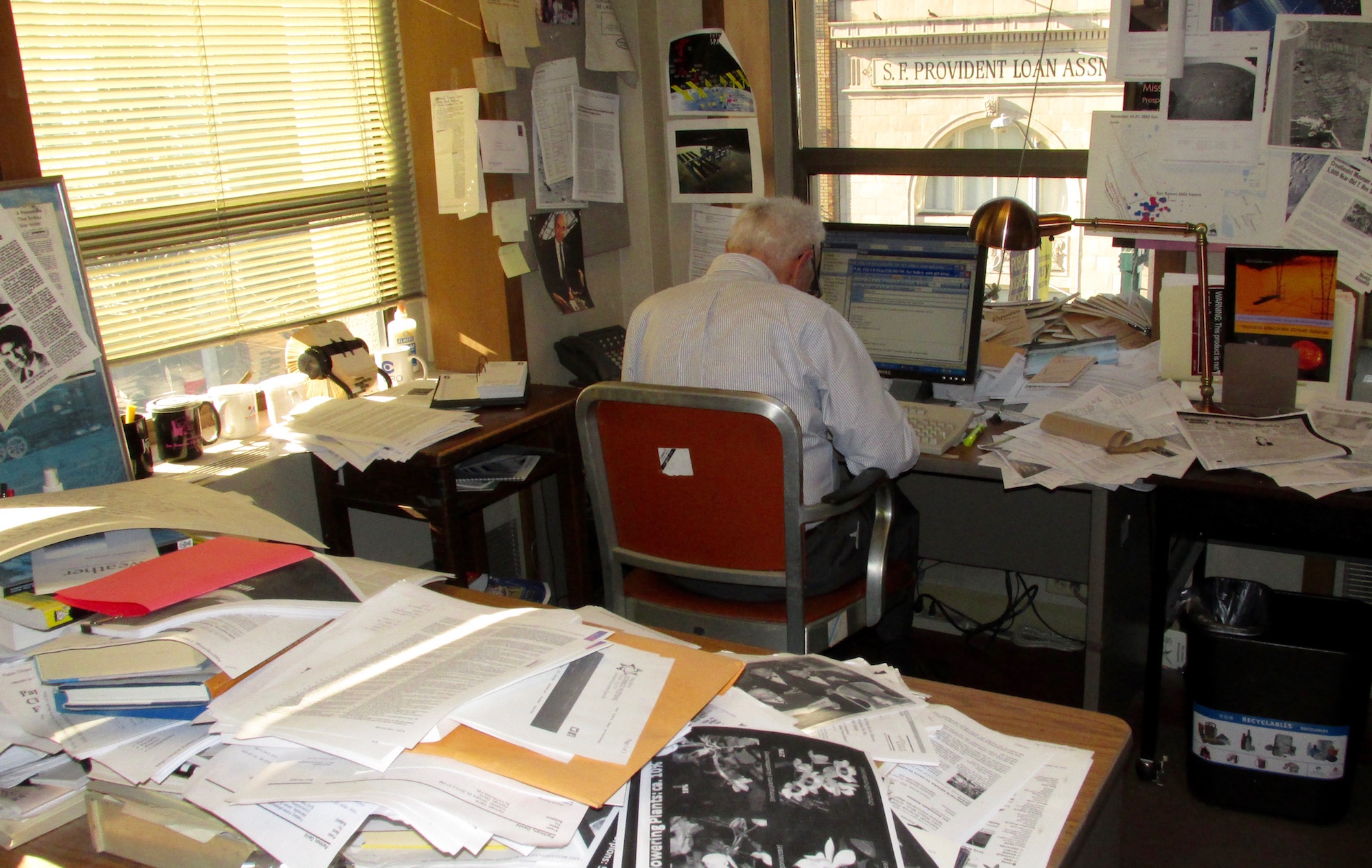 There was no mistaking Perlman's work space, piled high with research.