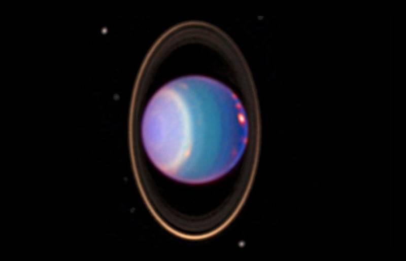 An infrared image of the ice giant Uranus and its thin rings, captured by the Hubble Space Telescope.