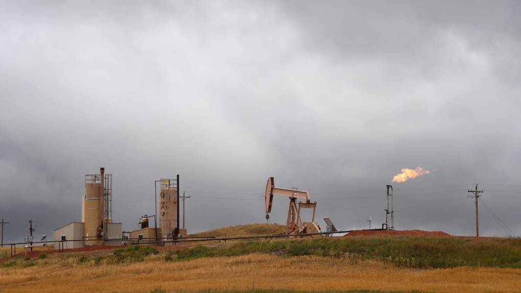 Pump jacks and a gas flare are seen near Williston, N.D., in 2016