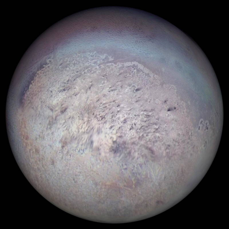 The largest moon of either ice giant planet, Triton, imaged by Voyager 2 in 1989. Triton may be one of the coldest spots in the solar system, though still shows signs of activity as it spews out plumes of nitrogen gas.