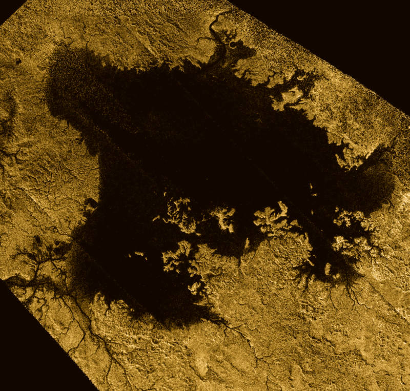 Ligiea Mare, one of Titan's large liquid methane seas. The image shows river-like drainage channels flowing into the sea.