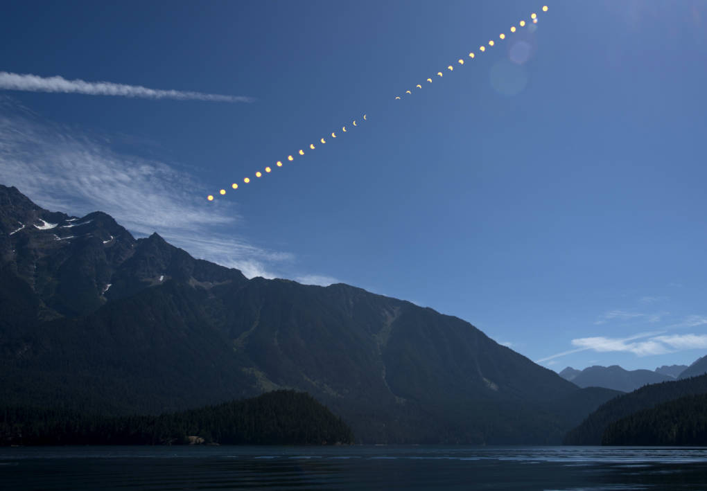 This composite image,  from NASA shows the progression of a partial solar eclipse over Ross Lake, in Northern Cascades National Park, Washington.