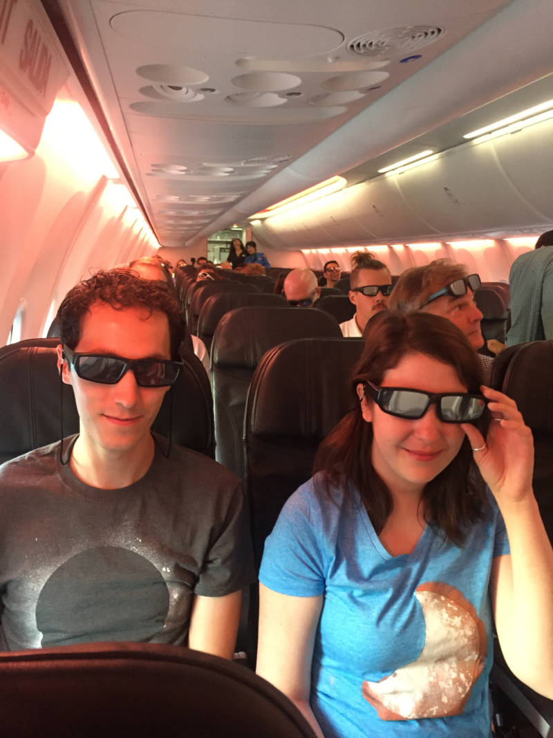Solar eclipse chasers prepare for takeoff on an Alaska Airlines flight Monday morning.
