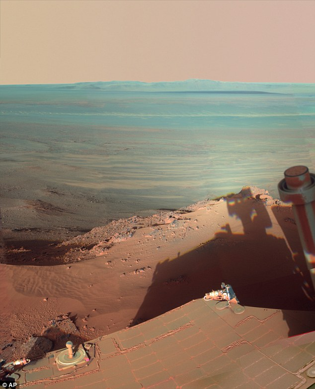 Opportunity casts a long shadow over the rim of Endeavour Crater when it arrived there in 2011.