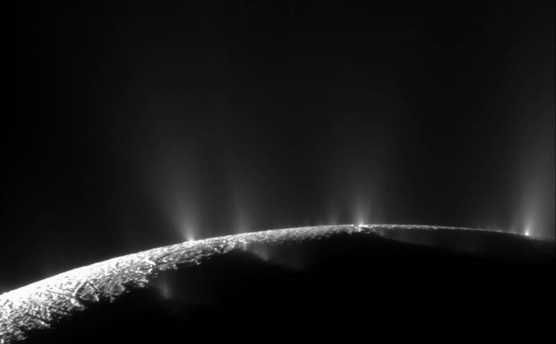 Plumes of water vapor erupting from the southern polar region of Enceladus.