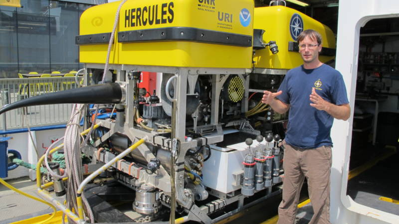 "Chris Roman describes the instruments on the ROV Hercules. ""The number one rule of ocean engineering is to keep the water out,"" says Roman, an Associate Professor of University of Rhode Island who has been onboard for many Nautilus expeditions"