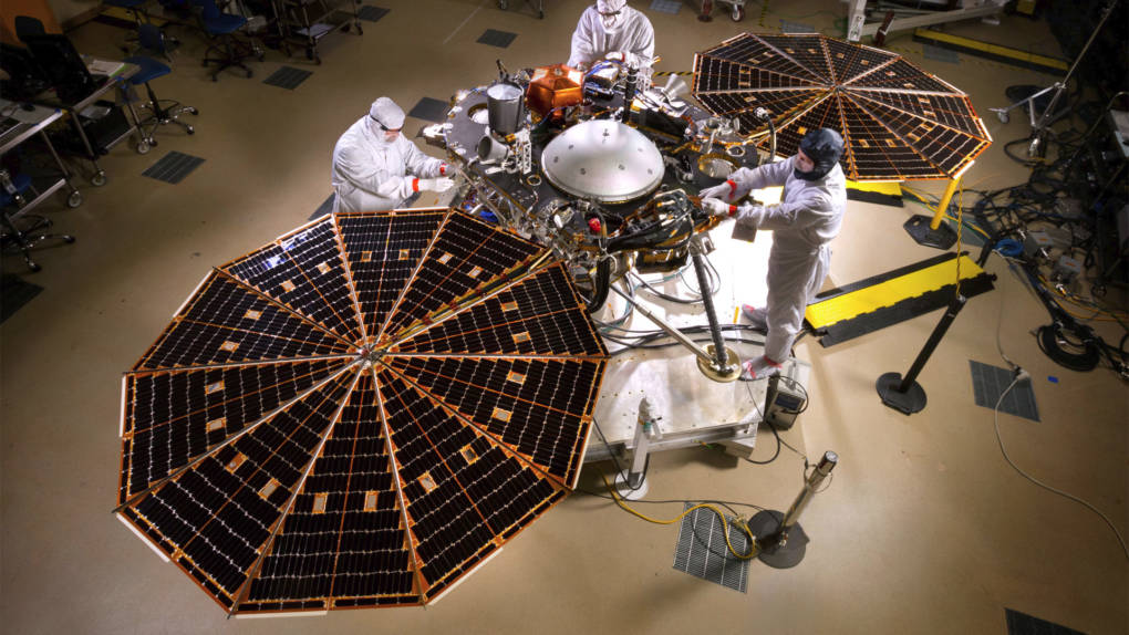 """The InSight lander with its solar panels deployed in """"On Mars"""" configuration."""