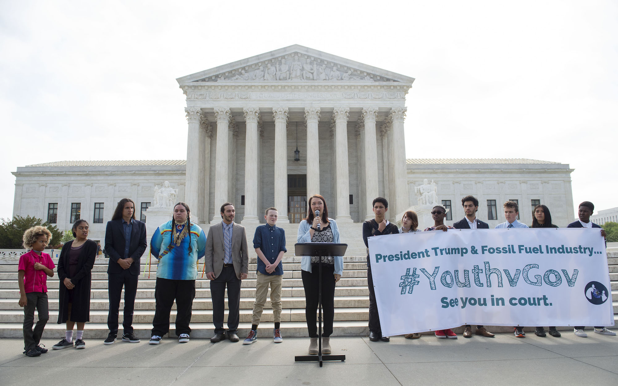 Youth plaintiff Kelsey Juliana speaks during a press conference in front of the U.S. Supreme Court in Washington, flanked by co-plaintiffs in their climate suit against the federal government.
