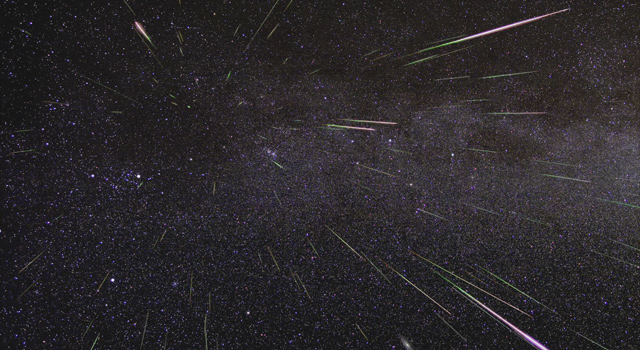"Long exposure of night sky capturing meteors of the annual August Perseid shower. The meteors appear to radiate from a spot in the sky, called the ""radiant""."