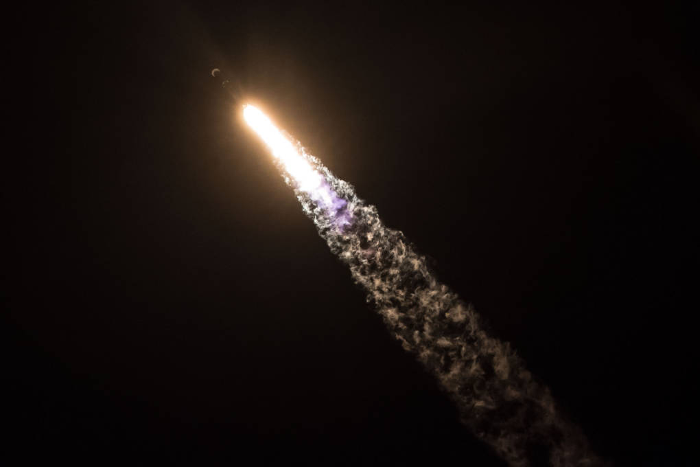 A rocket launching at nightime.