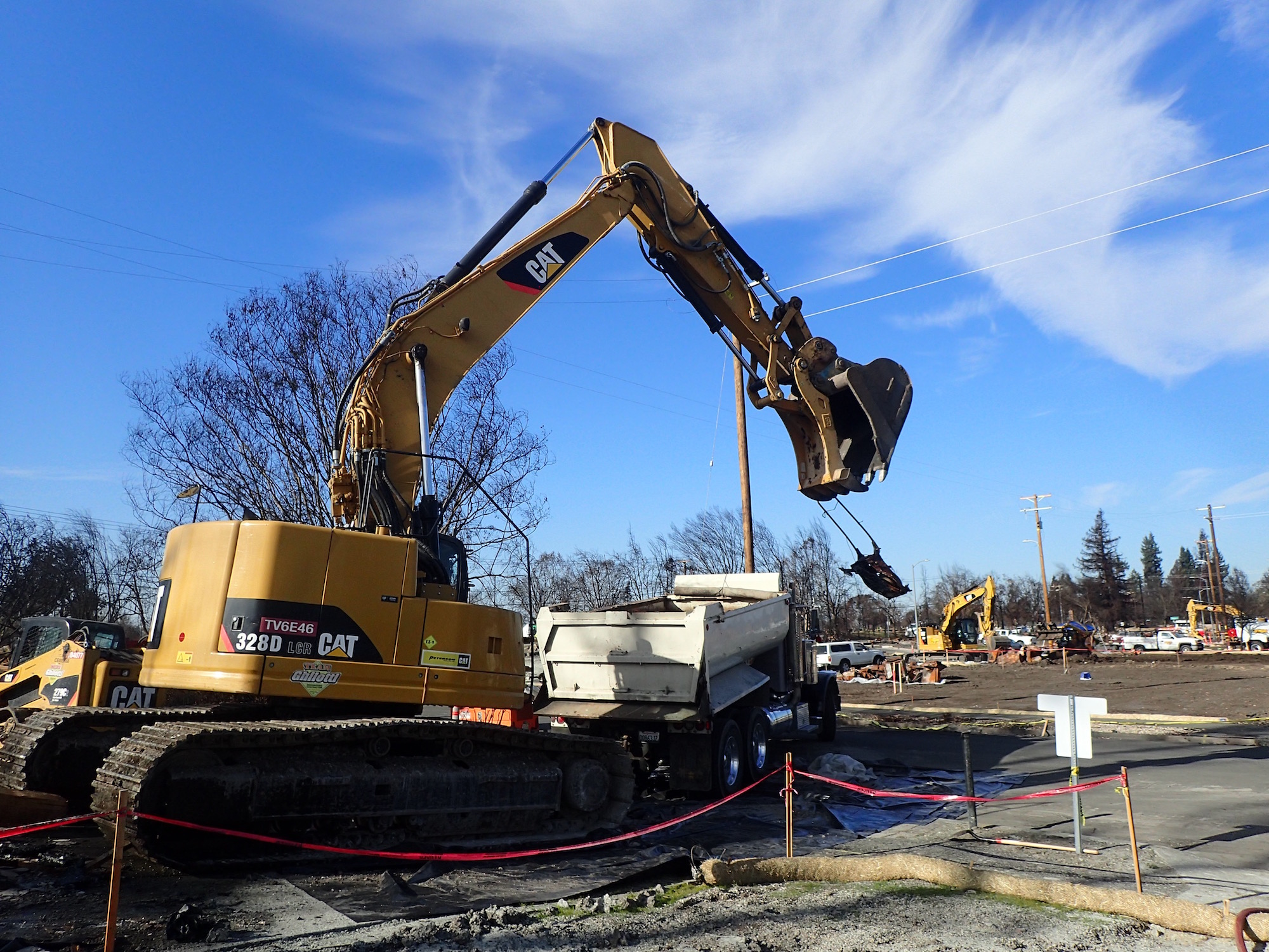 Excavator removing fire debris