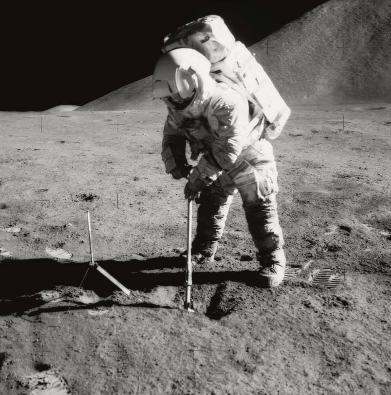 James B. Irwin, Apollo 15 astronaut, collecting a sample of lunar soil. Apollo rock and soil samples revealed that the Moon is composed largely of material from Earth.