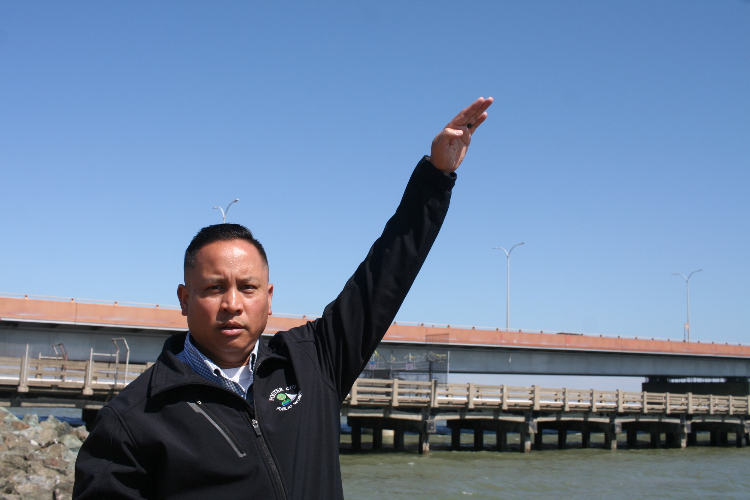 City Manager Jeff Moneda, standing on a levee.