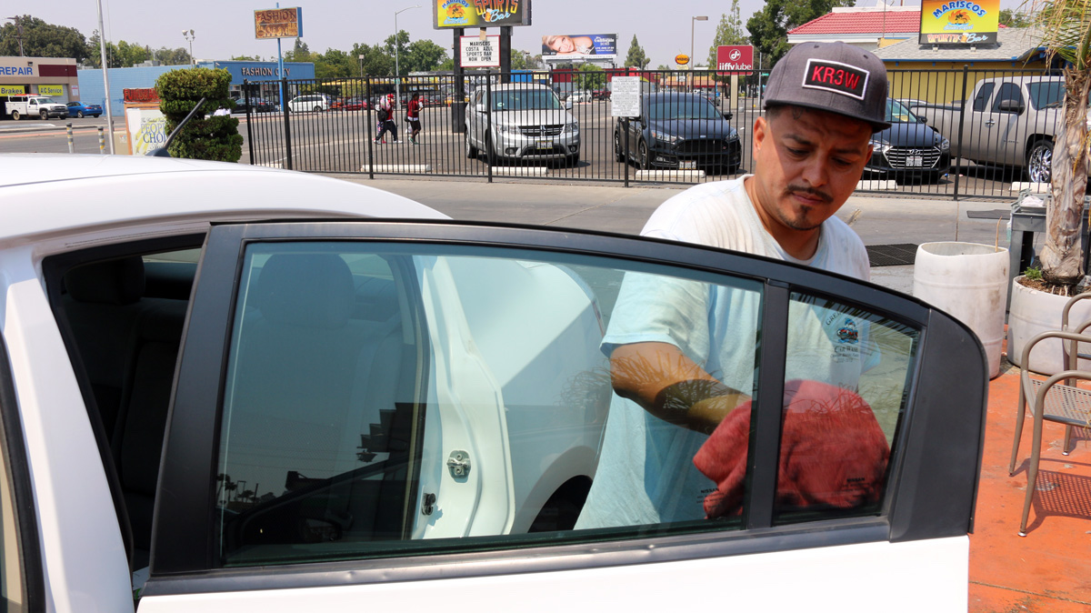 Photo: detailer Danny Espinoza at work in Fresno