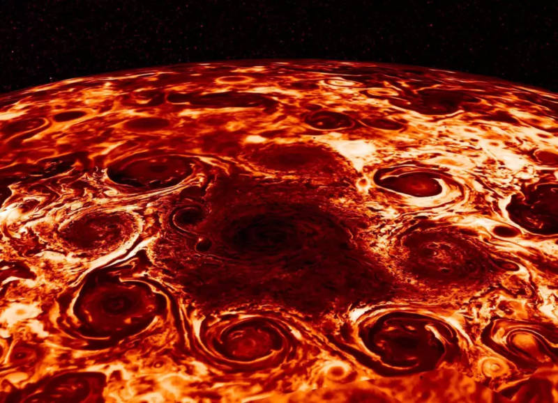 Infrared image of a central cyclone attended by eight smaller cyclones in Jupiter's north polar region.