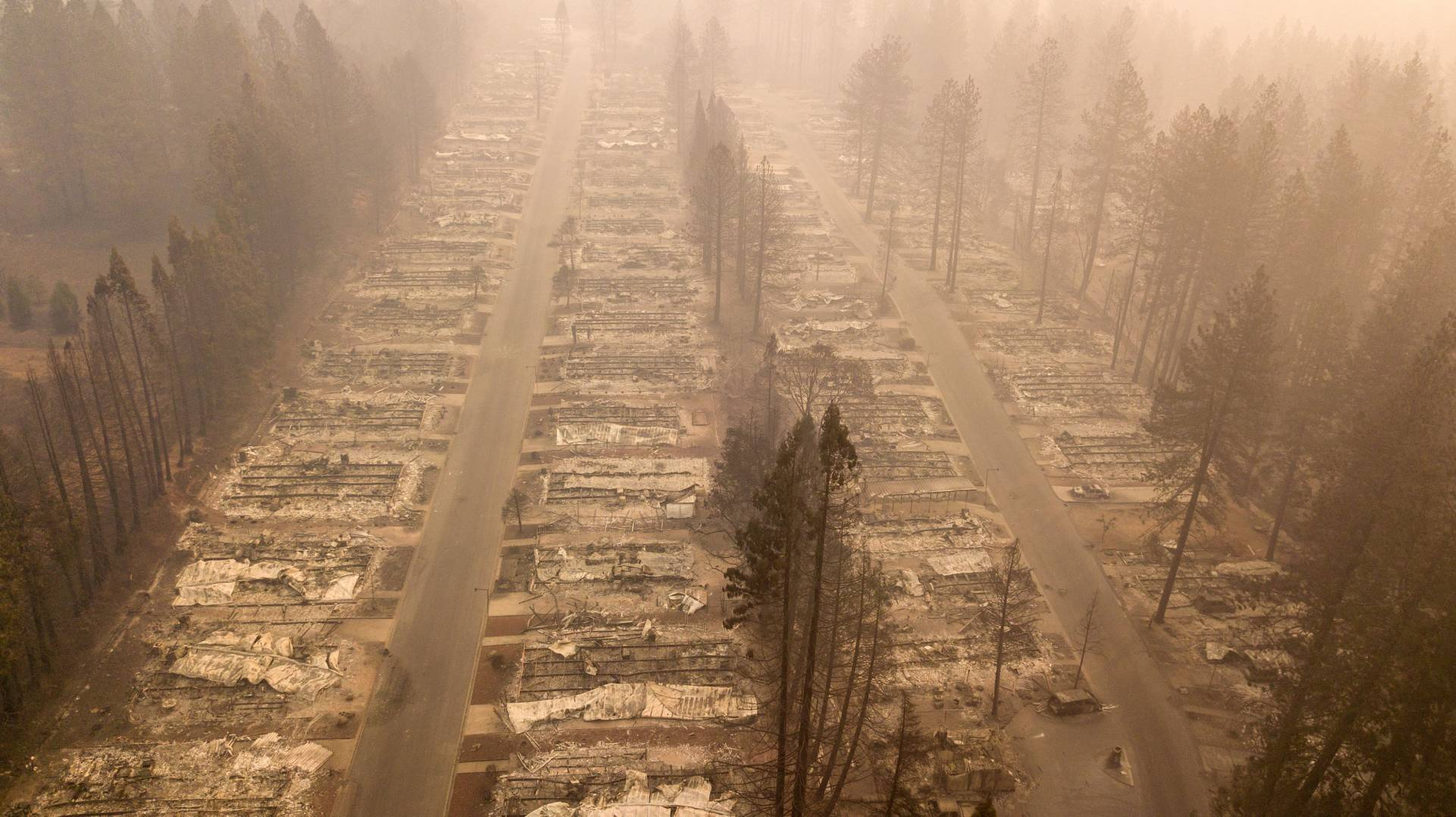 The Camp Fire consumed entire neighborhoods in Paradise, California. A massive federal report says climate change is contributing to larger wildfires as well as other deadly extreme weather. JOSH EDELSON/AFP/Getty Images