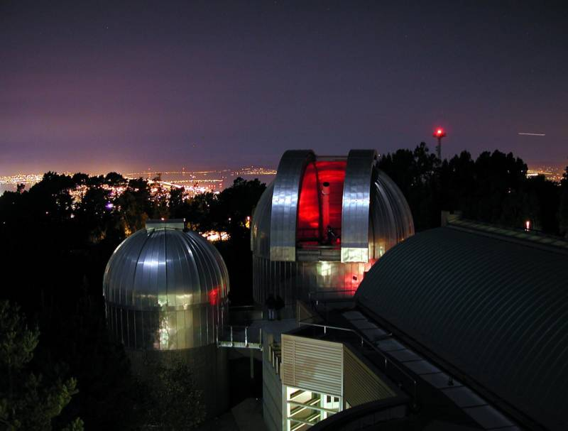The glow of urban light pollution is an unfortunate backdrop for the observatory complex at Chabot Space & Science Center.