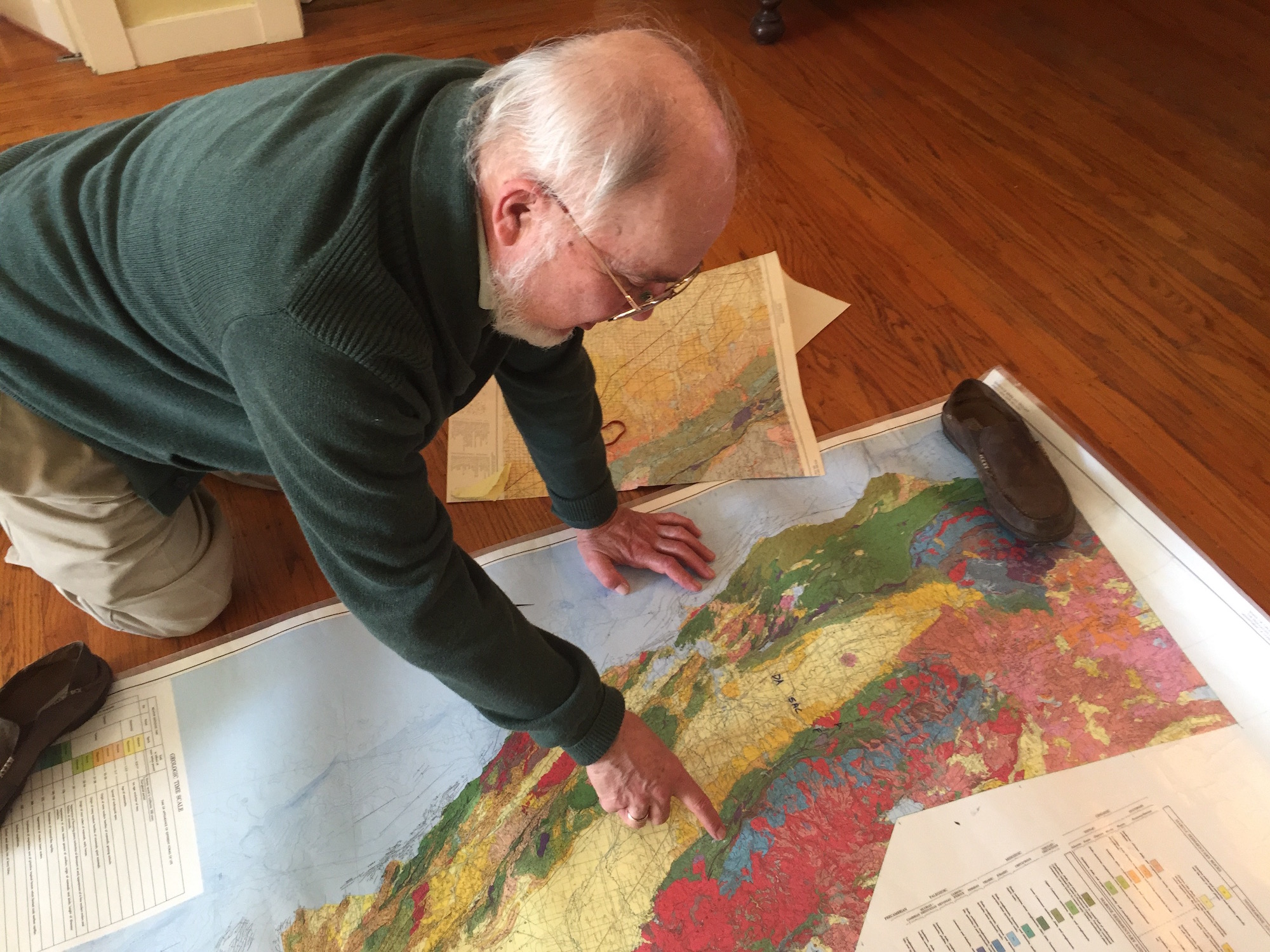 Photo: Moores with map on floor