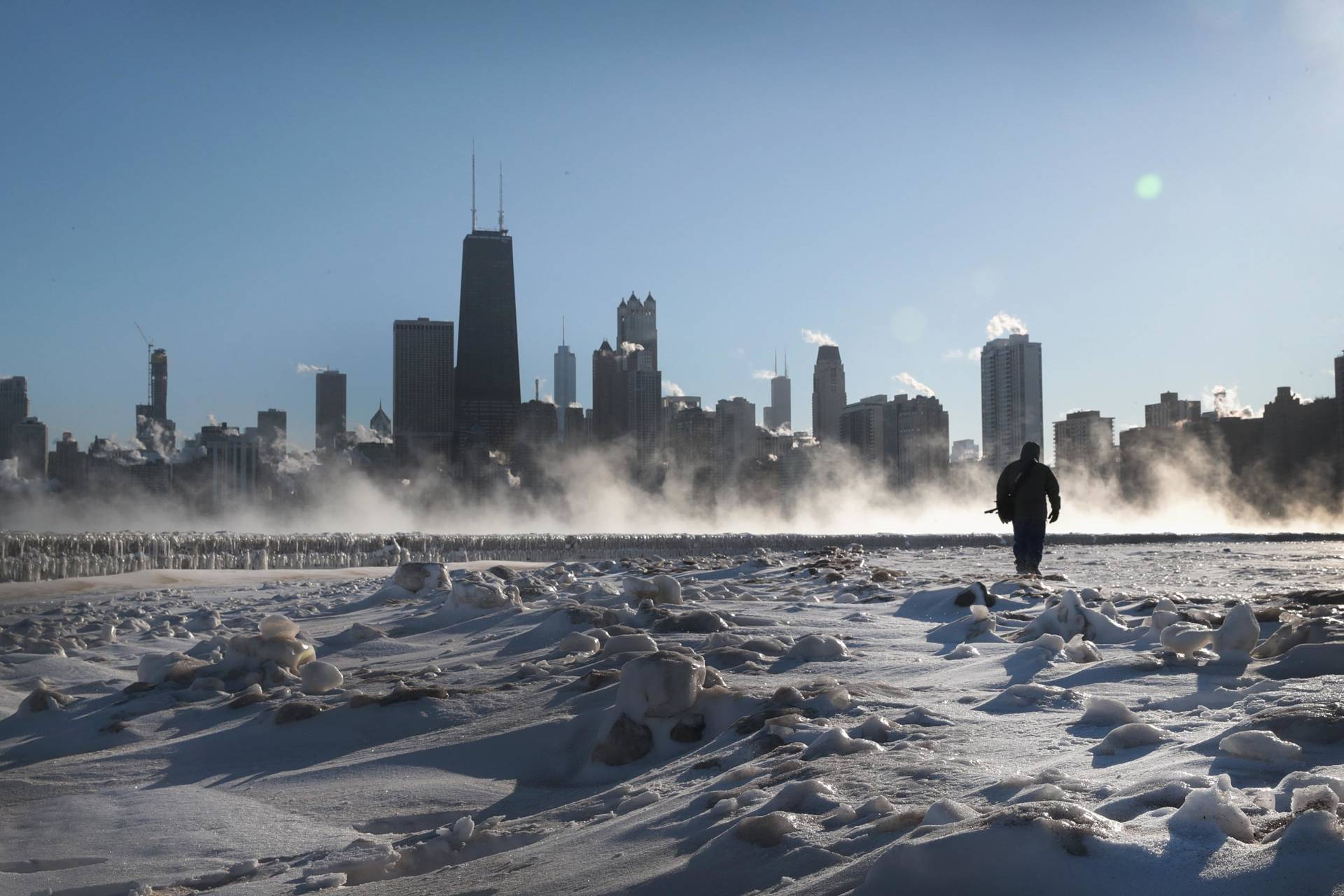 A man walks along the lakefront as temperatures hovered around -20 degrees on Jan. 30, 2019 in Chicago, Scott Olson/Getty Images
