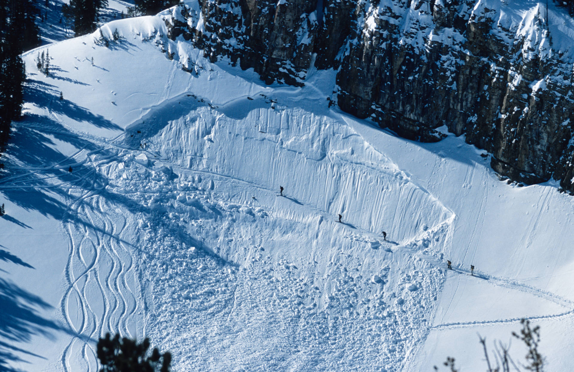 Five backcountry skiers cross a avalanche path while hiking outside of Jackson Hole Resort, Wyoming. KevinCass/iStockphoto