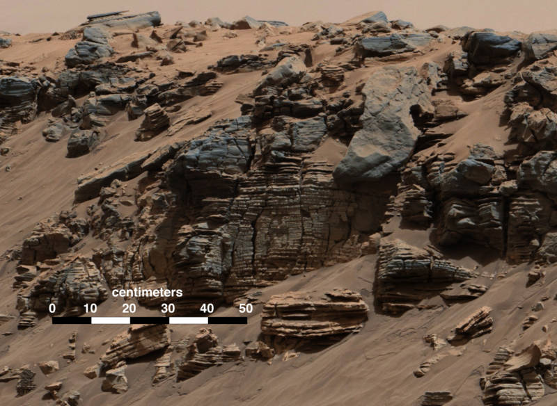 Fine sediment layers along Mount Sharp's lower slopes typical of lake bottom sediments deposited by the waters of river inflow. Picture taken in 2014 by the Curiosity rover.