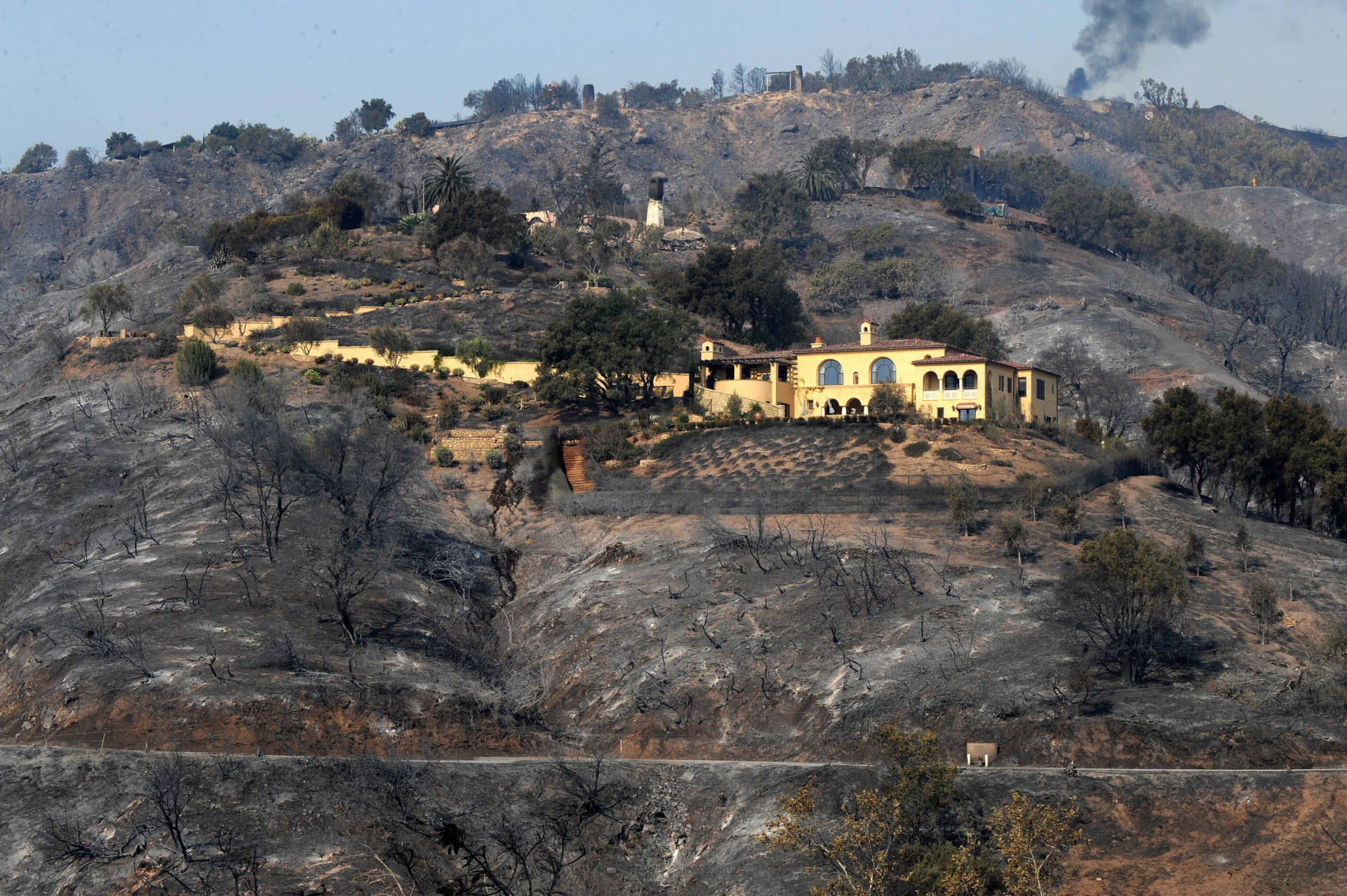 A mansion saved from a raging wildfire sits on a scorched hillside in Santa Barbara, November 2008.  Robyn Beck/AFP/Getty Images
