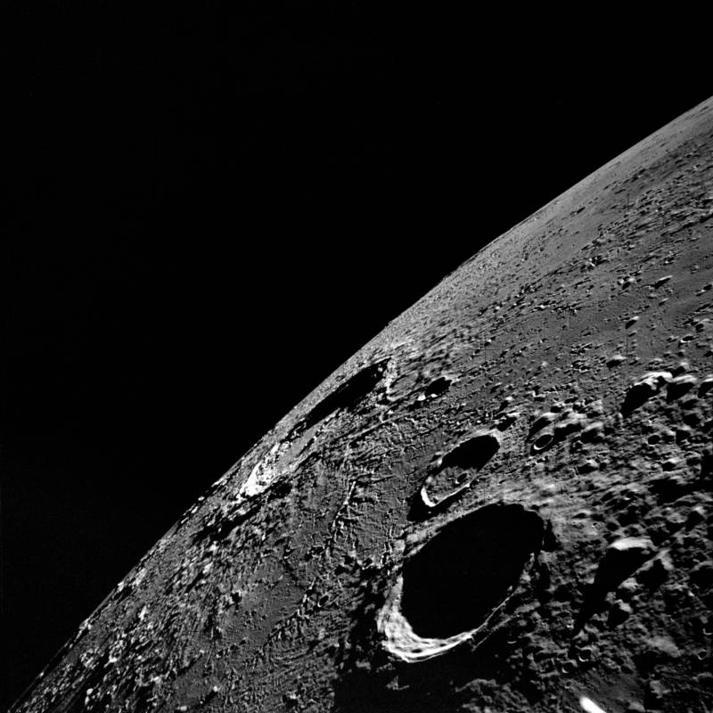 Picture of the moon's limb looking toward Copernicus crater, captured with a hand-held camera from the window of the Apollo 12 lunar landing module.
