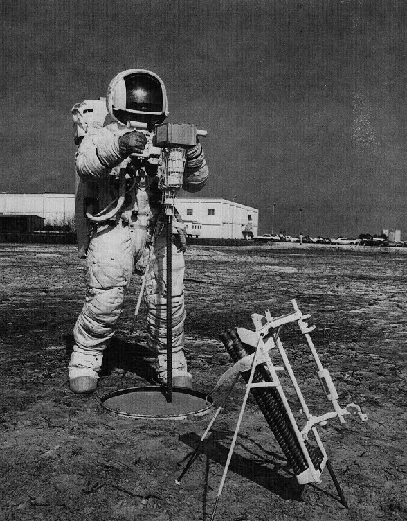 Battery powered hammering rock drill used by Apollo astronauts to collect lunar samples. Picture shows testing of the device at the Kennedy Space Center.