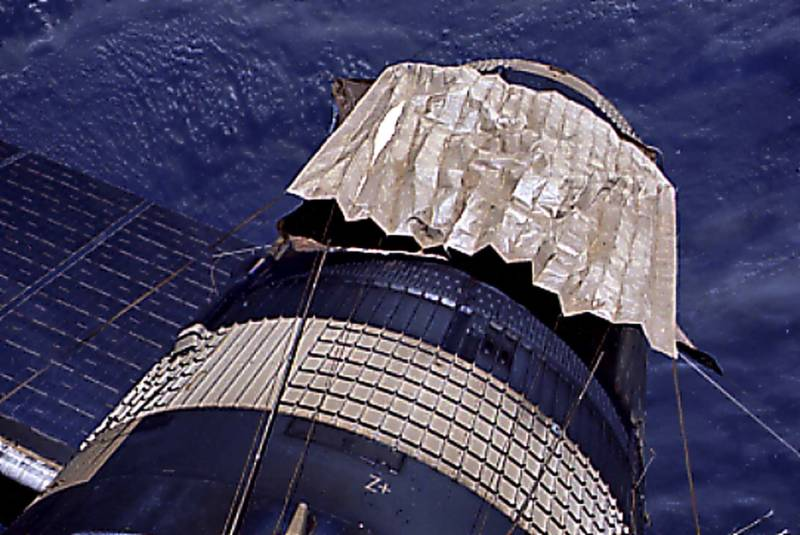 "A ""space blanket"" deployed to control solar heating of NASA's Skylab space station. The lightweight multi-layer foil material reflects almost 100% of the sunlight hitting it."
