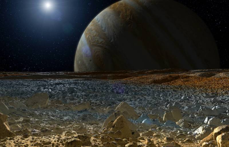 Artist concept of a view from Europa's icy surface, looking out upon Jupiter.