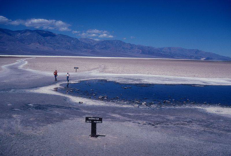 At the lowest point in the continental US, Badwater, in Death Valley National Park, sits at the edge of a great pan of salt minerals left behind when the paleo-lake Manly, which filled the valley only 10,000 years ago, dried up under changing climate conditions. A shallow pool of briny water can be found here, maybe not unlike ponds and puddles evidence is showing existed on the drying Mars in the distant past.