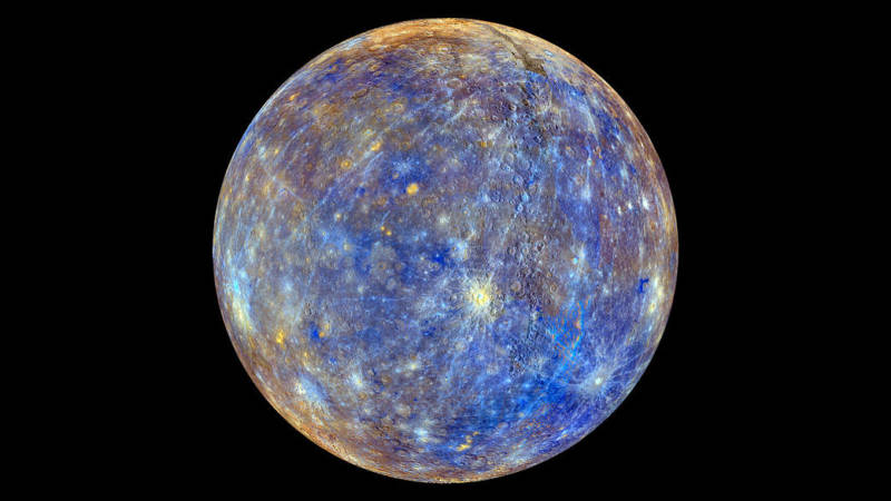 A false color image of the planet Mercury captured by NASA's MESSENGER spacecraft. The colors represent differences in chemical and mineralogical composition on Mercury's surface.