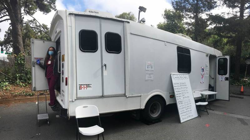 Nurse Ana Mota at the Opiate Treatment Outpatient Program (OTOP) mobile van at Zuckerberg San Francisco General Hospital. Since March, medical staff have treated many methadone patients outside to allow for social distancing.