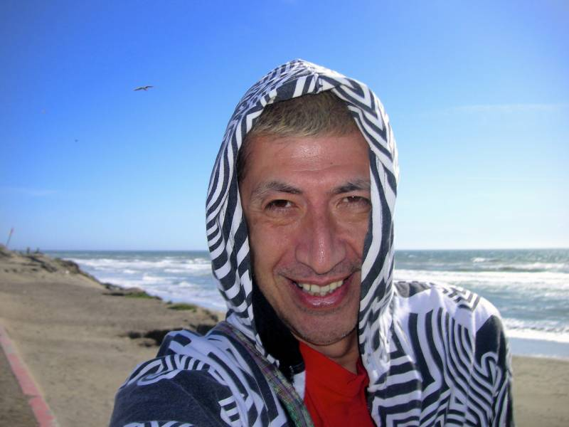 Jesus Guillen snaps a selfie at Ocean Beach in San Francisco.