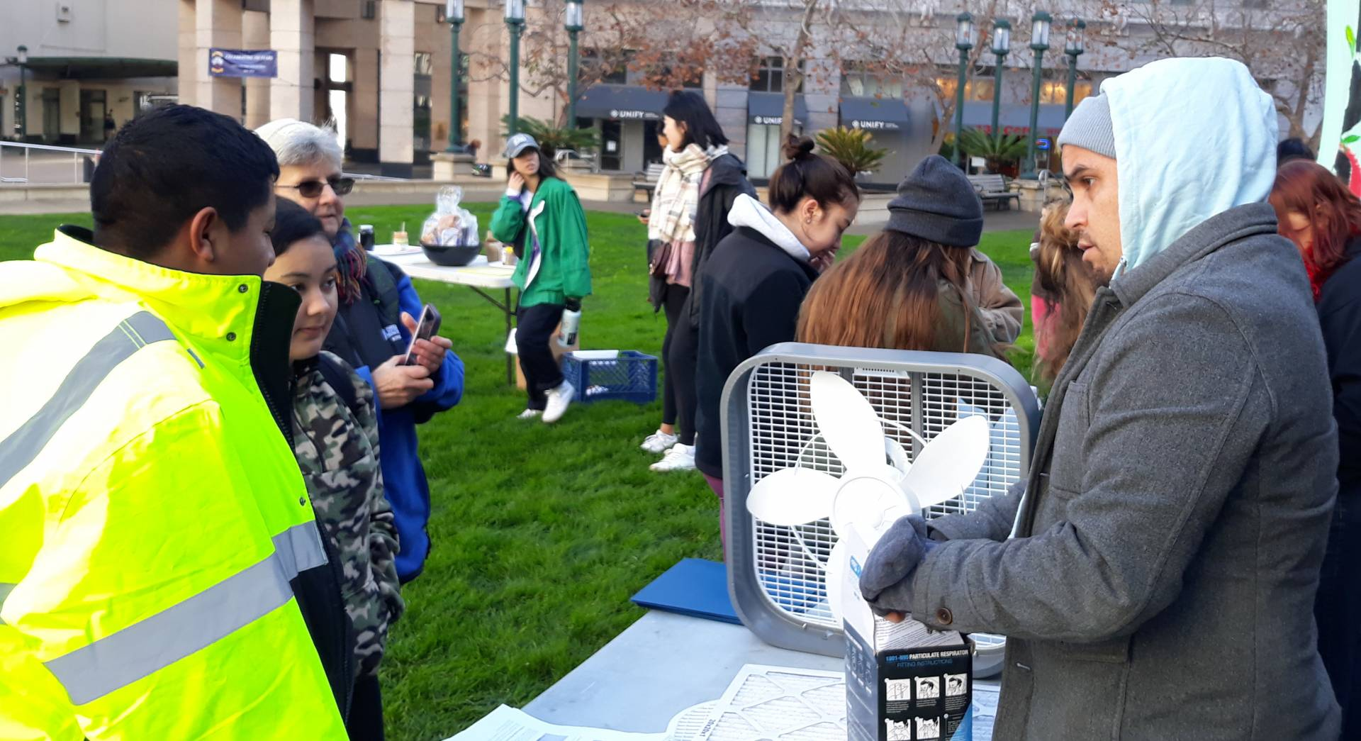Dani Cornejo, an educator with the Mycelium Youth Network, teaches young people how to make their own air purifiers out of a box fan and air filter at a climate change event in Oakland in January. Lil Milagro Henriquez/Mycelium Youth Network