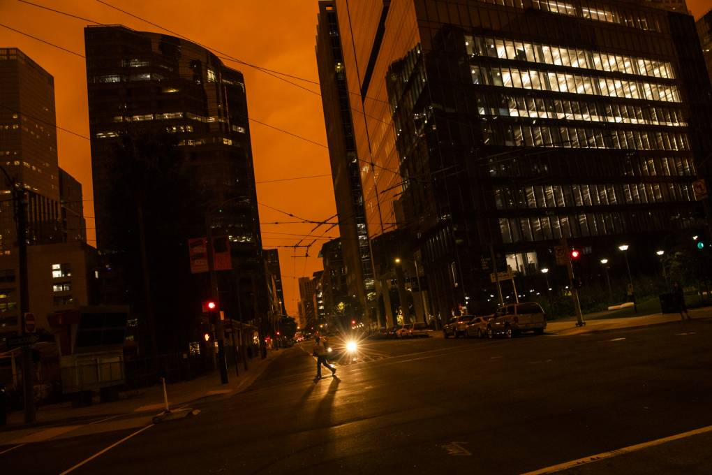 An orange glow is seen over a darkened Howard Street as smoke from various wildfires burning across Northern California mixes with the marine layer on Sept. 9, 2020 in San Francisco, California.   Philip Pacheco/Getty Images