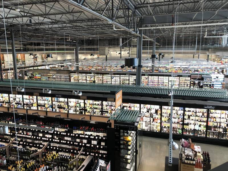 The exposed ceiling of this Raley's on Freeport Boulevard in Sacramento shows some of the thousands of feet of pipes that cycle refrigerants through a store, keeping products cold.