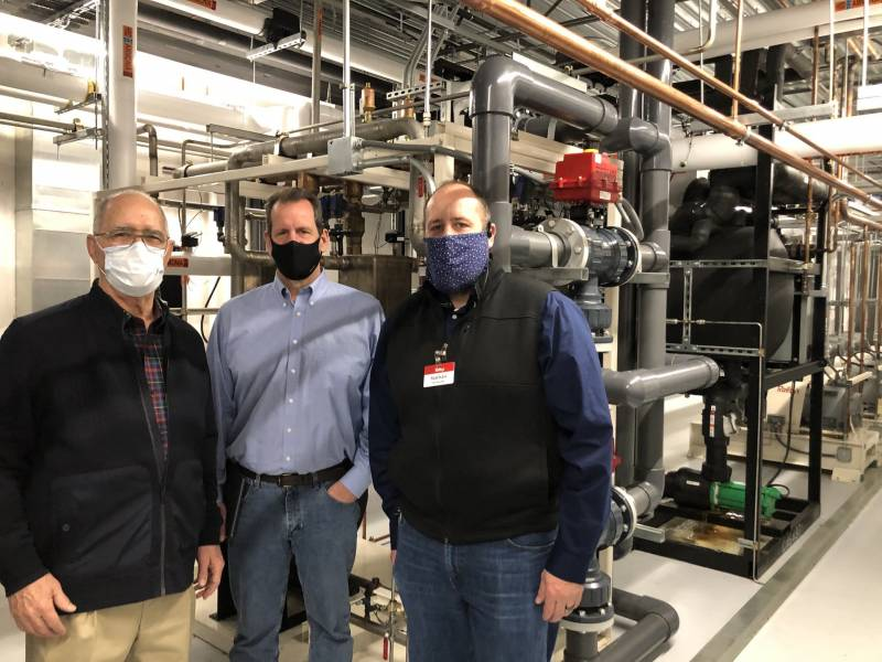 (Left to right) Ed Estberg, Mark Koppang, and Nathan Smith in the machine room of the Raley's on Freeport Boulevard in Sacramento. Carbon dioxide removes heat from the products on the floor of the store, and then ammonia, which is only in the machine room, removes that heat from the carbon dioxide. The heat is discharged as steam or warm air from the roof of the store.