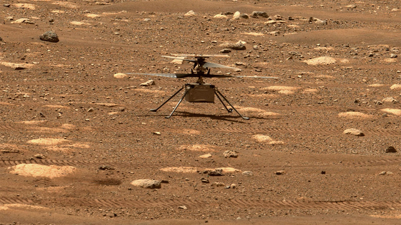 The Mars Helicopter, Ingenuity, resting on the ground on Mars, awaiting its first historic flight on another world.  NASA/JPL-Caltech